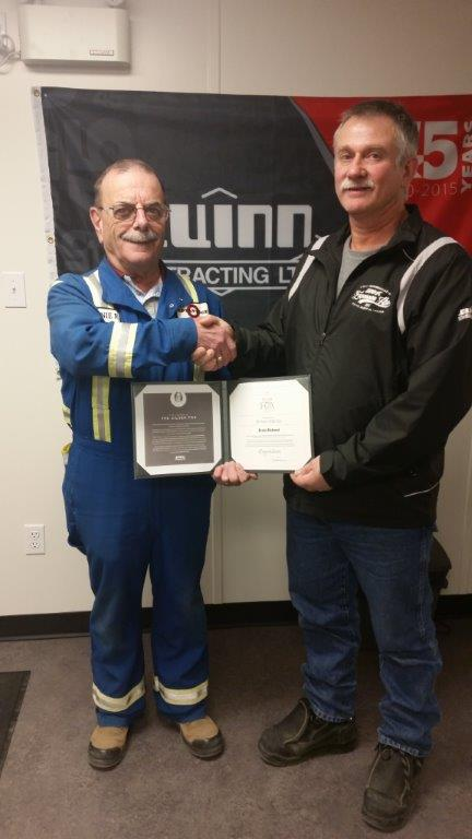 35 Year Employee, Ernie Richard receives the distinguished Silver Fox Award from Site Manager, Lonie Albers.